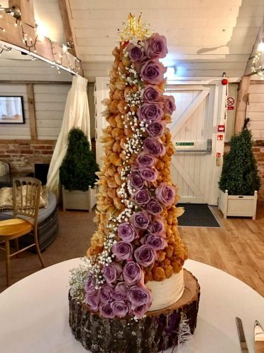 Croquembouche Piece montee photo too close as hidden behind a curtain for a reveal. At Devizes