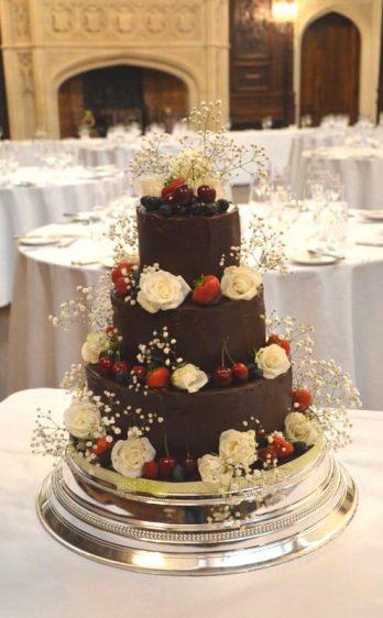 Chocolate wedding cake fresh fruits & flowers